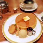 丸福珈琲店 食べたのはハルカス店です。ホットケーキのミルクティーアイス添え。セットで1200円。玉子の風味がきいていて、サクッと美味しい(^_^)メープルより蜂蜜のが合いそうです。